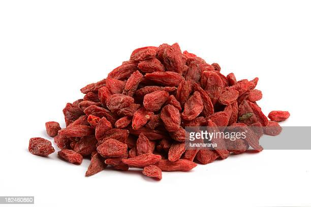 Heaping pile of dried Goji berries on white background