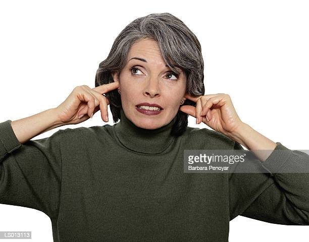 hear no evil - fingers in ears stock pictures, royalty-free photos & images