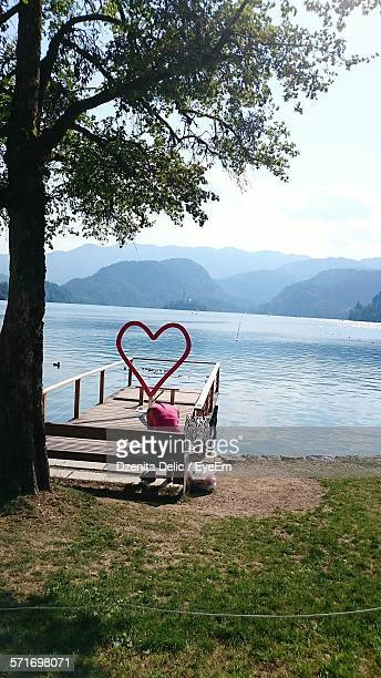Hear Shape Frame On Edge Of Scenic Mountain Lake