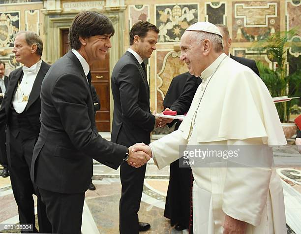 Heard Coach of the German National Team Joachim Loew shakes hands with Pope Francis during a private audience with Pope Francis at the Vatican Palace...