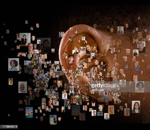 hearing and researching the crowd - image foto e immagini stock