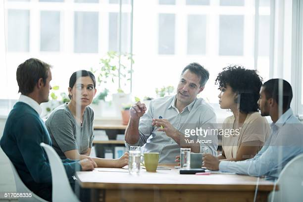 hearing him out - business meeting stock pictures, royalty-free photos & images