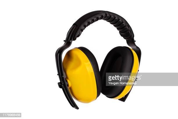 hearing protection yellow ear muffs, personal protective equipment, safety equipment isolated on white background - hearing protection stock pictures, royalty-free photos & images