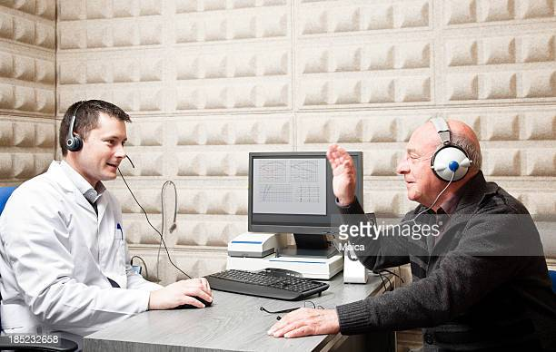 hearing test - ear exam stock photos and pictures