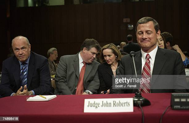 HEARINGFormer Sen Fred Thompson left now advisor to Roberts looks on during a break in the hearing as Judge John G Roberts testifies during his...