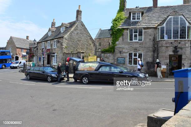 hearse and funeral procession at corfe, dorset, uk - hearse stock photos and pictures