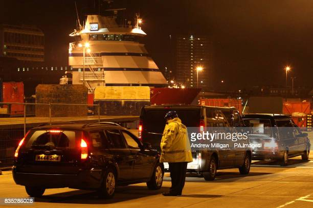 A hearse and people carrier arrive at Aberdeen Harbour to take away the bodies of some of the men who were killed when a helicopter crashed in the...