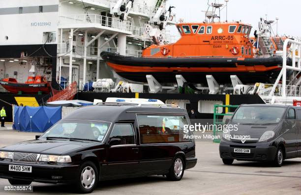 A Hearse and people carrier take away the bodies of some of the men who were killed when a helicopter crashed in the North Sea after they were taken...