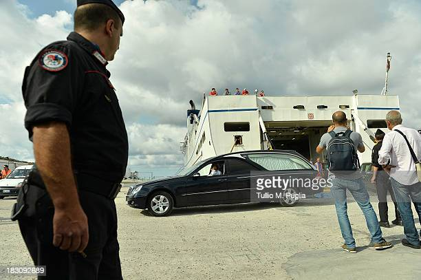 A hearse arrives at the Lampedusa port on October 4 2013 in Lampedusa Italy The search for bodies continues off the coast of Southern Italy as the...
