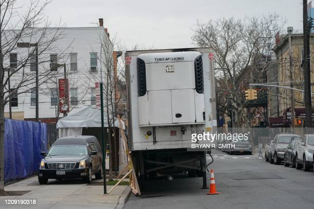 Hearse arrives to transport a body from a refrigeration truck serving as a temporary morgue outside of Wyckoff Hospital in the Bushwick section of...