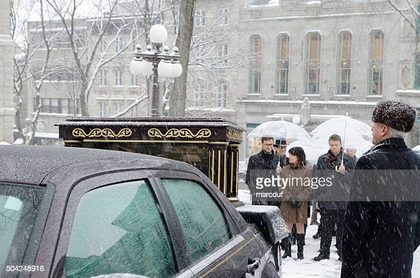 hearse awaiting urn of the deceased with family  for procession - old quebec stock pictures, royalty-free photos & images