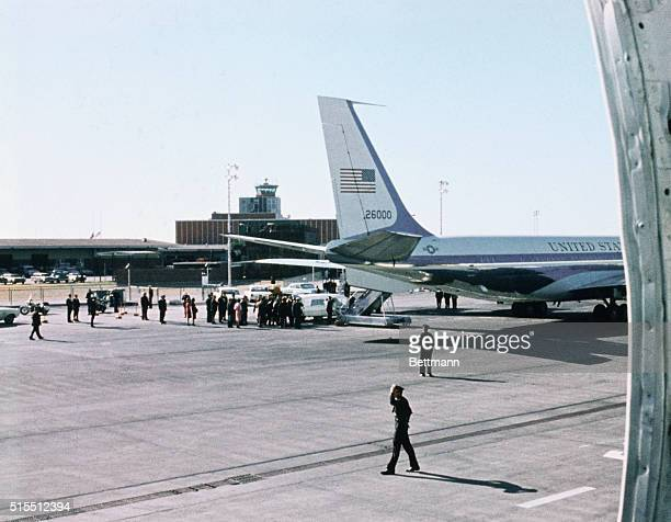 Hearse bearing the body of President John F Kennedy arrives at Love Field November 22nd and approaches the tail of the Presidential plane