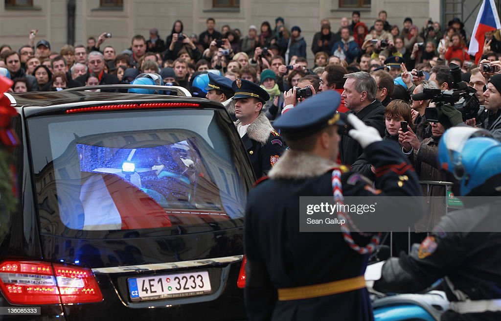 A hearse bears the coffin of former Czech President Vaclav Havel away past moruners and Prague Castle guards following Havel's state funeral at St. Vitus Cathedral on December 23, 2011 in Prague, Czech Republic. International heads of state and thousands of mourners came to pay their last respects to the dissident playwright who led the Velvet Revolution that forced communist rule in Czechoslovakia to crumble in 1989, and died in the early morning of December 18 in his sleep at the age of 75.
