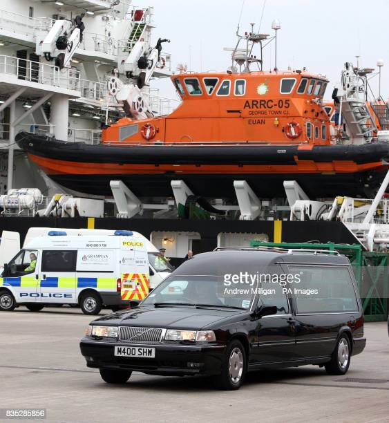 A Hearse carries the bodies of some of the men who were killed when a helicopter crashed in the North Sea after they were taken off the Caledonian...