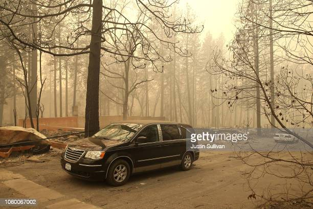 A hearse carries the remains of two deceased victims of the Camp Fire on November 10 2018 in Paradise California Fueled by high winds and low...