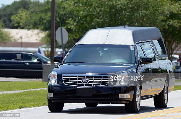 A hearse carrying Army Sgt 1st Class Daniel Ferguson leaves the funeral on its way to the cemetary on April 12 2014 in Lakeland Florida Ferguson was...