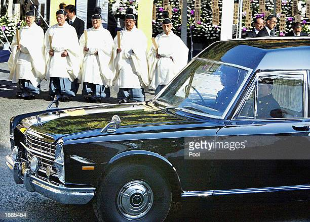 A hearse carrying the body of late Japanese Prince Takamado cousin of Emperor Akihito arrives at Toshimagaoka Cemetery November 29 2002 in Tokyo...