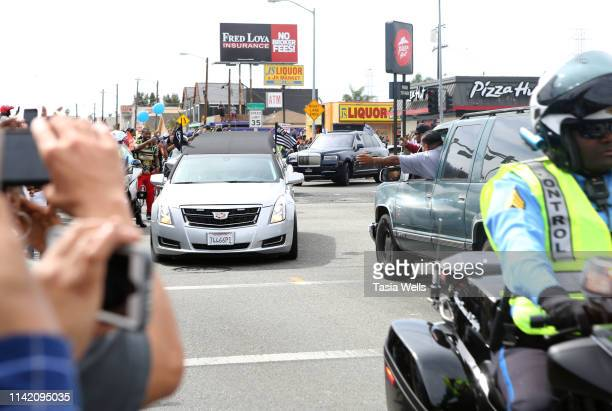 A hearse carrying the body of Nipsey Hussle passes Century and Vermont during Nipsey Hussle's Celebration of Life and Funeral Procession on April 11...