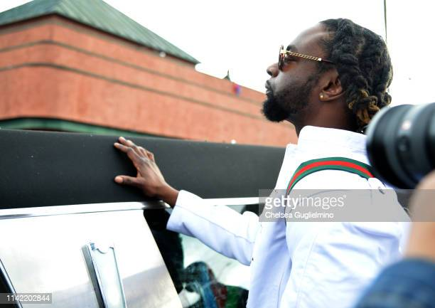 A hearse carrying the body of Nipsey Hussle passes The Marathon Clothing Store during Nipsey Hussle's Celebration of Life and Funeral Procession on...