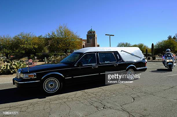 A hearse carrying the casket of US District Court Judge John Roll leaves St Elizabeth Ann Seton church after a funeral service on January 14 2011 in...