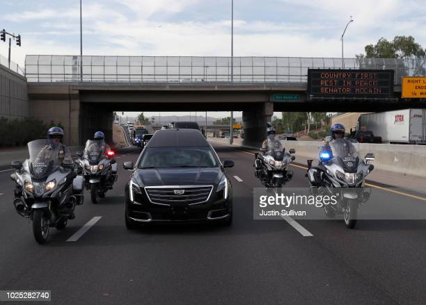 A hearse carrying the casket of US Sen John McCain is escorted to a memorial service at the North Phoenix Baptist Church on August 30 2018 in Phoenix...