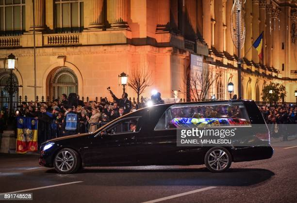 A hearse carrying the coffin of King Michael I of Romania arrives on December 13 2017 to the former Royal Palace that houses the National Arts Museum...