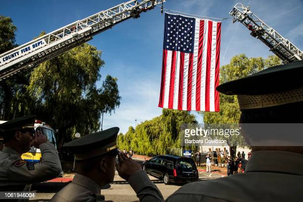 A hearse carrying the coffin of Ventura County Sheriff Sgt Ron Helus is driven into The Calvary Community Church for his memorial service on November...
