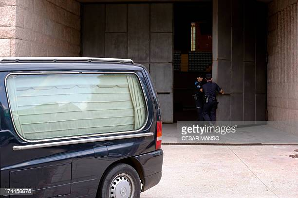 A hearse carrying victims of a train accident leaves a morgue near the city of Santiago de Compostela on July 26 2013 A train hurtled off the tracks...