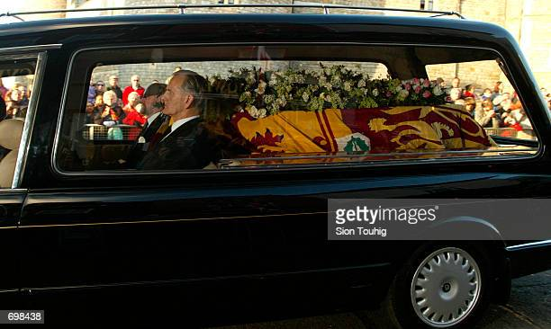 A hearse containing Princess Margarets coffin leaves St Georges Chapel at Windsor Castle February 15 2002 on the way to Slogh Crematorium The funeral...