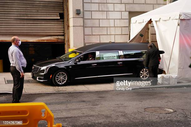 A hearse containing the body of Glen Ridge New Jersey police officer Charles Roberts leaves the makeshift morgue at Lenox Hill Hospital on May 11...