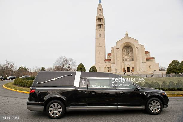 A hearse containing the body of the late Supreme Court Justice Antonin Scalia arrives at the Basilica of the National Shrine of the Immaculate...