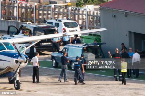 A hearse containing the coffin of late French musician Johnny Hallyday is pictured after its arrival by plane at the SaintJeanGustave III airport on...