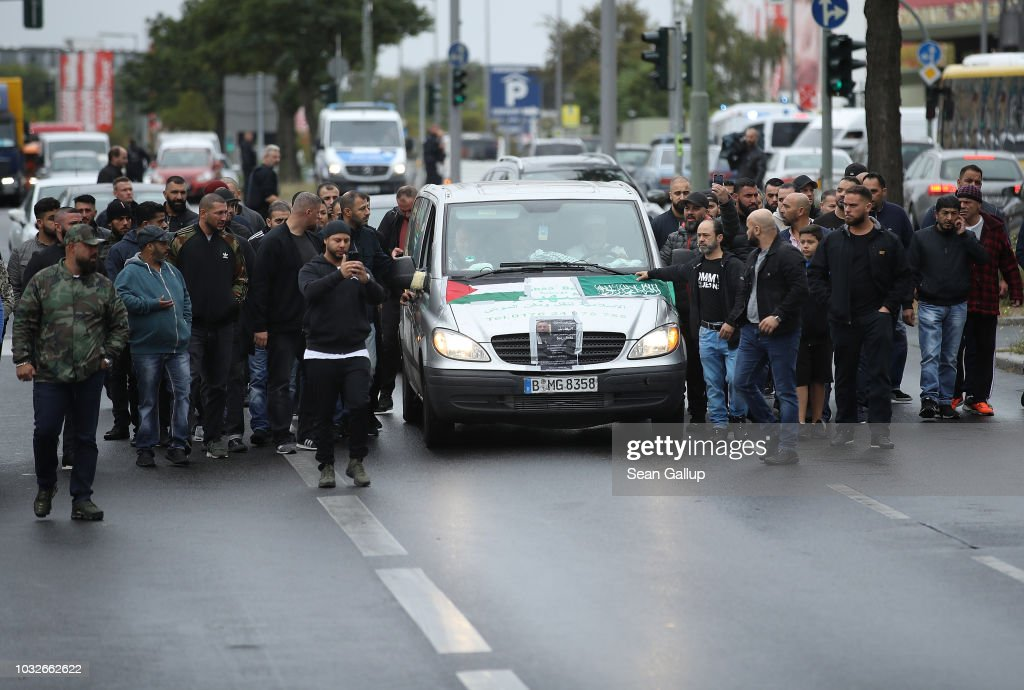 A hearse draped with a Palstinian flag arrives carrying the body of Nidal R., an associate of a Berlin Arab clan, at the New 12 Apostles cemetery on September 13, 2018 in Berlin, Germany. Nidal R., 36, a multiple felon, was gunned down by assailants who managed to flee the scene at a public park last Sunday. Berlin has a growing number of Arab, Kurdish and Turkish clans involved in organized crime.