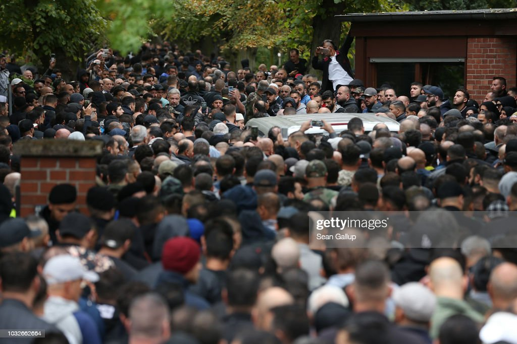 A hearse draped with a Palstinian flag arrives carrying the body of Nidal R., an associate of a Berlin Arab clan, through a crowd of mourners gathered at the New 12 Apostles cemetery on September 13, 2018 in Berlin, Germany. Nidal R., 36, a multiple felon, was gunned down by assailants who managed to flee the scene at a public park last Sunday. Berlin has a growing number of Arab, Kurdish and Turkish clans involved in organized crime.