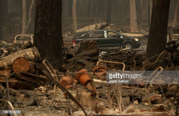 A hearse drives through a mobile home park that was destroyed by the Camp Fire on November 14 2018 in Paradise California Fueled by high winds and...