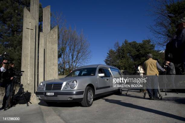 A hearse leaves a funeral parlour in Sion on March 13 where several bodies were taken following a bus crash in which some 28 people were killed...
