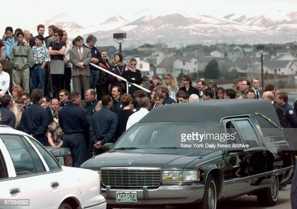 Hearse leaves church after funeral services for Cassie Burnell one of the students slain in massacre at Columbine High School in Littleton Colo where...
