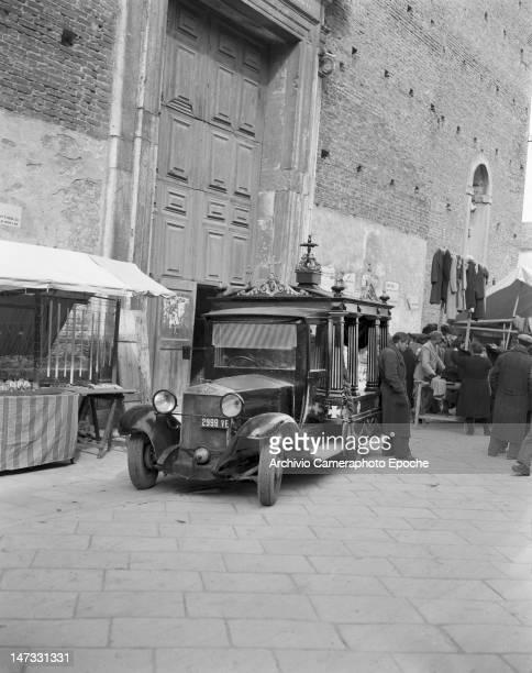 A hearse parked outside a church in Chioggia Venice 1950
