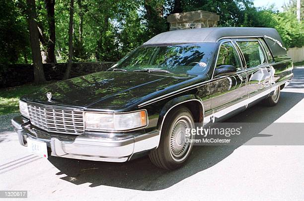 A hearse reportedly carrying the body of actor Anthony Quinn enters a private drive near the Quinn family home June 8 2001 in Bristol RI Quinn who...