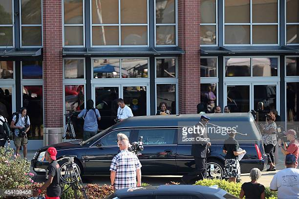 A hearse sits in front of the Friendly Temple Missionary Baptist Church for the funeral of Michael Brown on August 25 2014 in St Louis Missouri...