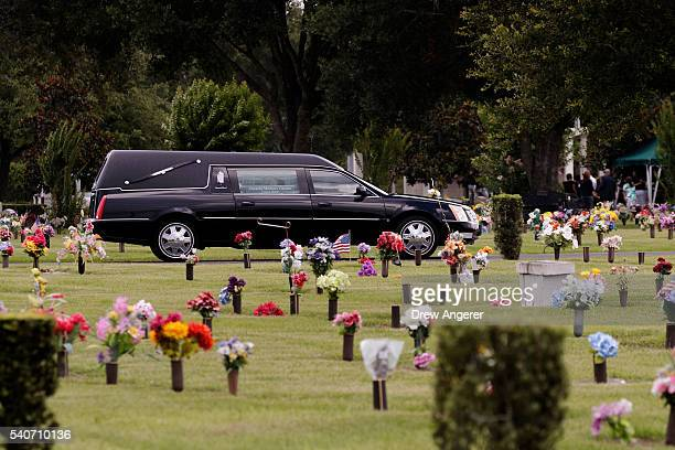 Hearse that carried the body of Kimberly Morris drives through the cemetery after the burial for Morris June 16 2016 in Kissimmee Florida Morris who...
