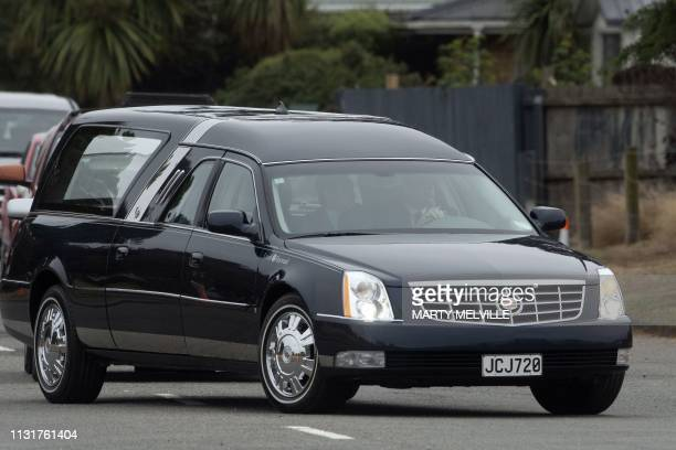 A hearse transporting the mortal remains of a victim killed in New Zealand's twin mosque attacks arrives at the Memorial Park cemetery in...