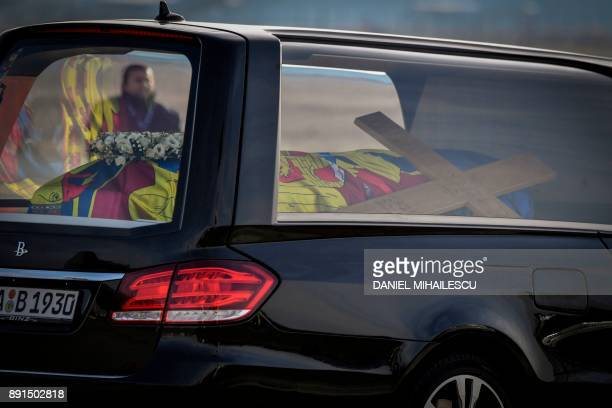 A hearse transports the coffin of King Michael I of Romania at Henry Coanda International airport in Otopeni city next to Bucharest on December 13...