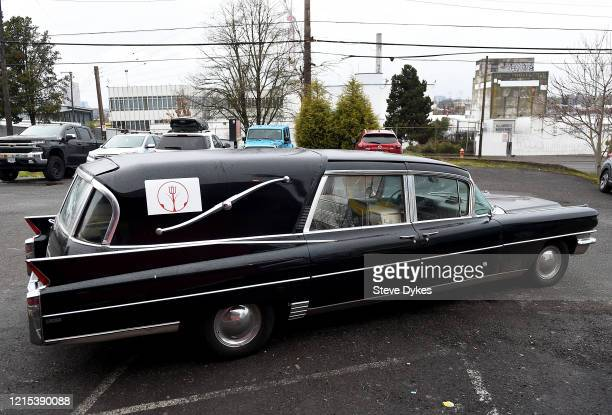 A hearse used as a delivery vehicle sits in the parking lot ready to head out to deliver food on March 27 2020 in Portland Oregon A local Portland...