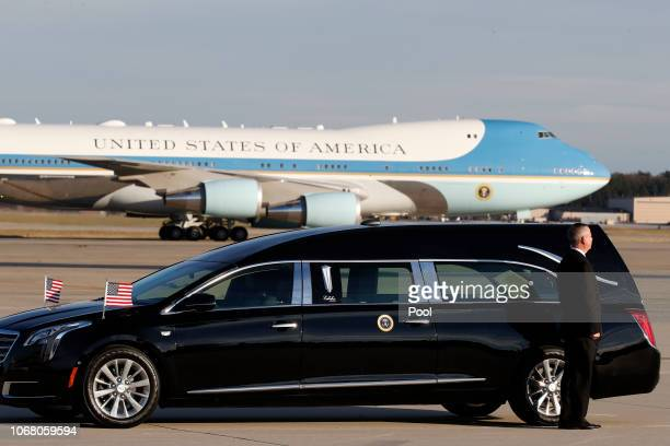 A hearse waits as the US Air Force 747 being called 'Special Mission 41' lands carrying the casket of the remains of former US President George HW...