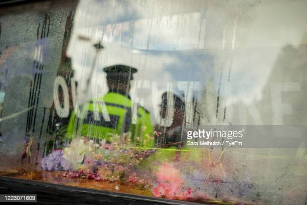 a hearse with condensation on window with reflection of police man - police stock pictures, royalty-free photos & images