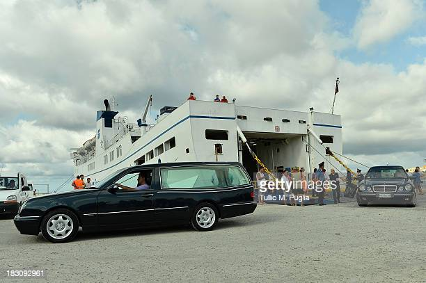 Hearses arrive at the Lampedusa port on October 4 2013 in Lampedusa Italy The search for bodies continues off the coast of Southern Italy as the...