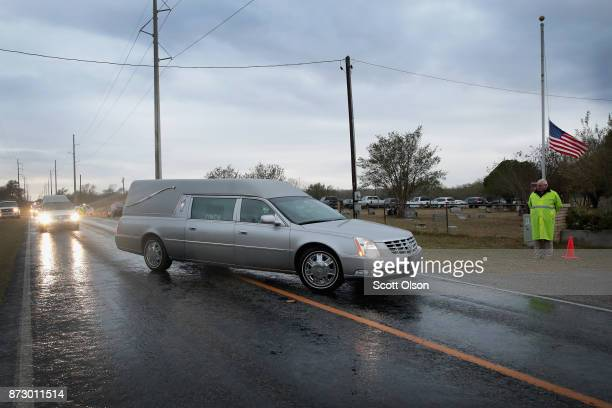Hearses carrying the remains of Ricardo Rodriguez and his wife Therese arrive at the Sutherland Springs Cemetery on November 11 2017 in Sutherland...