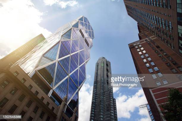 """hearst tower, headquarters of hearst communications and the first """"green"""" high-rise office building completed in new york city, at 57th street in midtown manhattan, new york city - conglomerate stock pictures, royalty-free photos & images"""