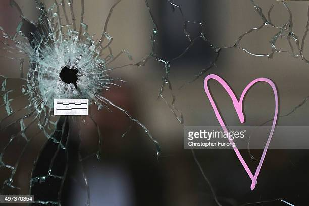 A heart adorns the bullet damaged window of the Casa Nostra Cafe one of the scenes of last friday's terror attacks on November 16 2015 in Paris...